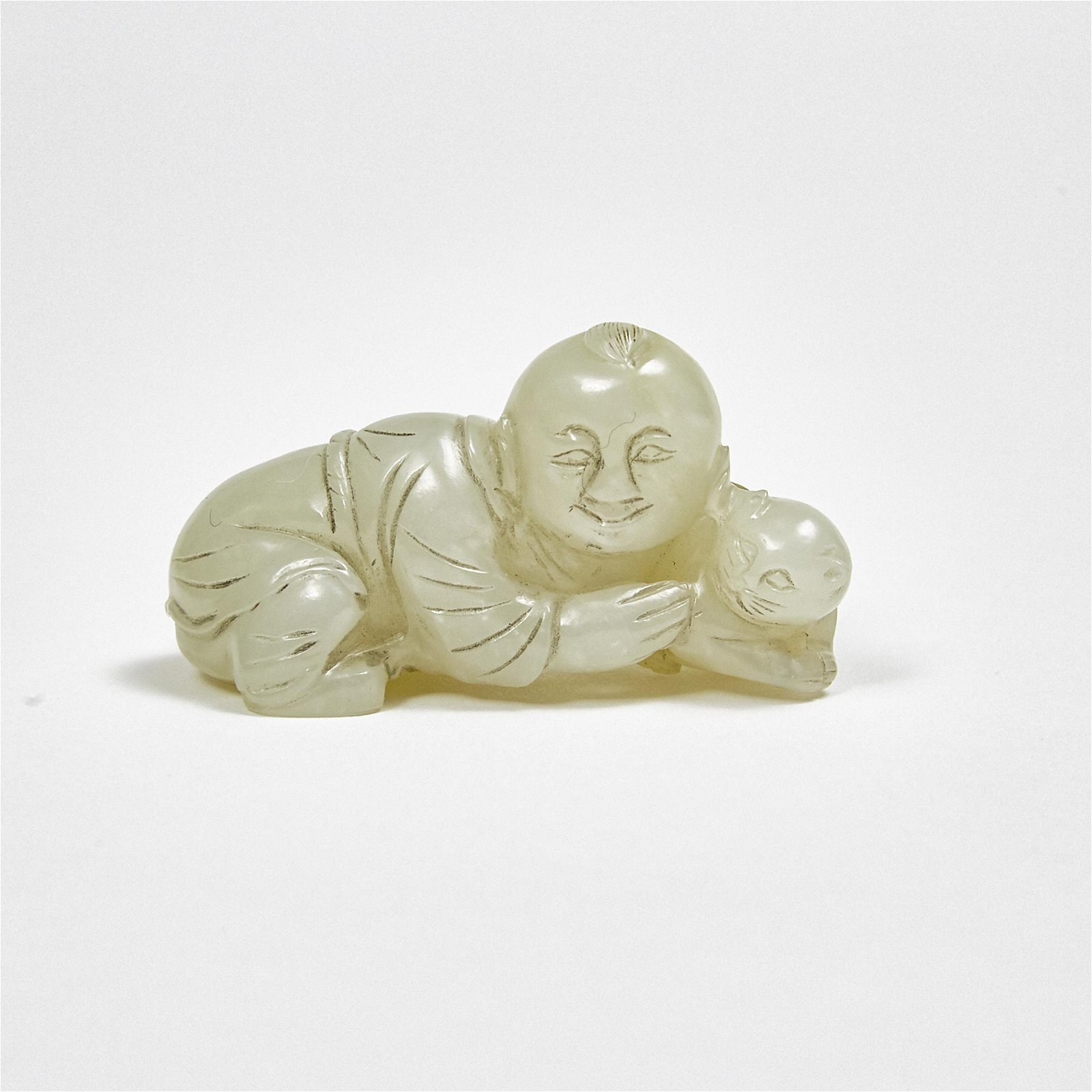 A White Jade Boy with Cat Carving, Qing Dynasty