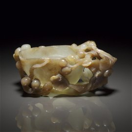 A Pale Celadon and Russet Jade 'Chilong' Pouring