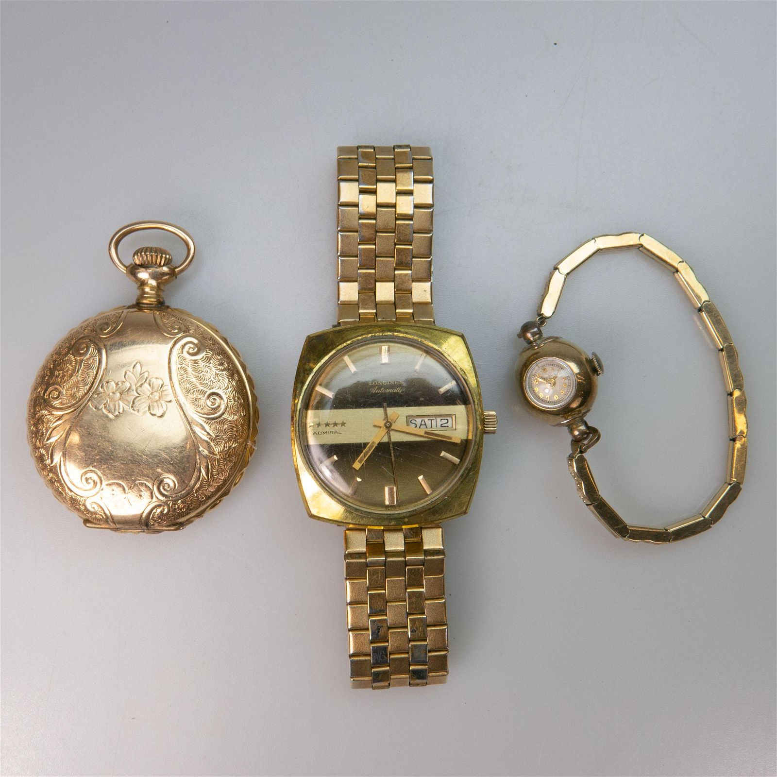 Three Various Timepieces, including a Longines