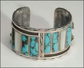 Native Art 2 sterling silver open bangles, the first
