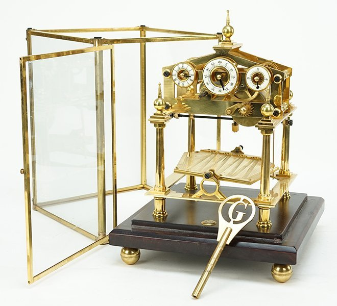 An English Brass Clock. - 2