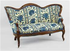 A Victorian Carved Walnut Settee.