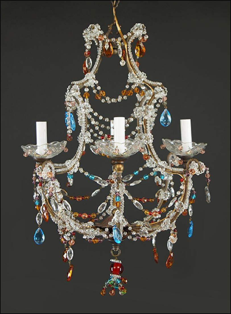 A Regency Style Four-Light Chandelier.