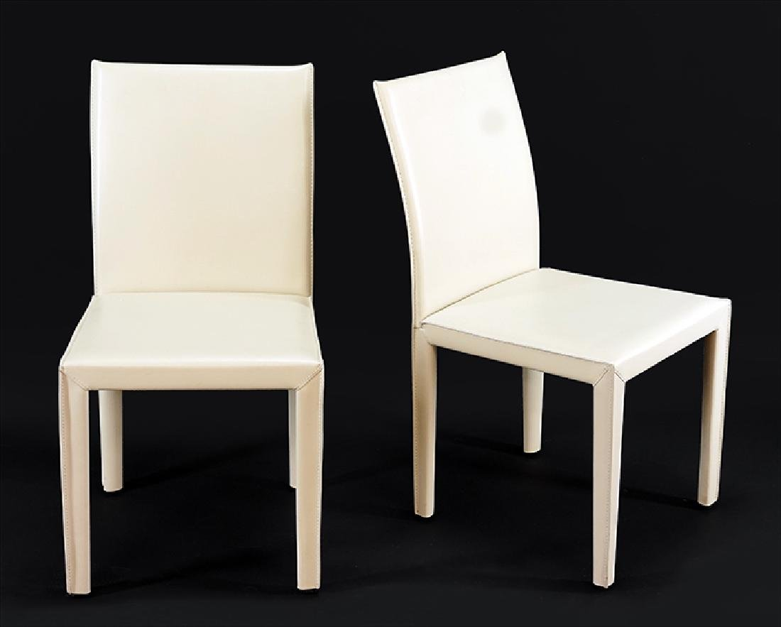 A Set of Eight Maria Yee Dining Chairs.