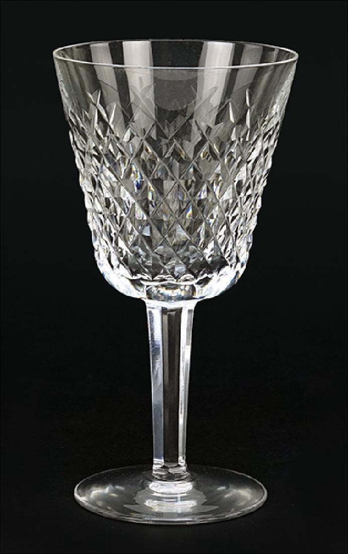 A Set of Twelve Waterford Crystal White Wine Glasses in