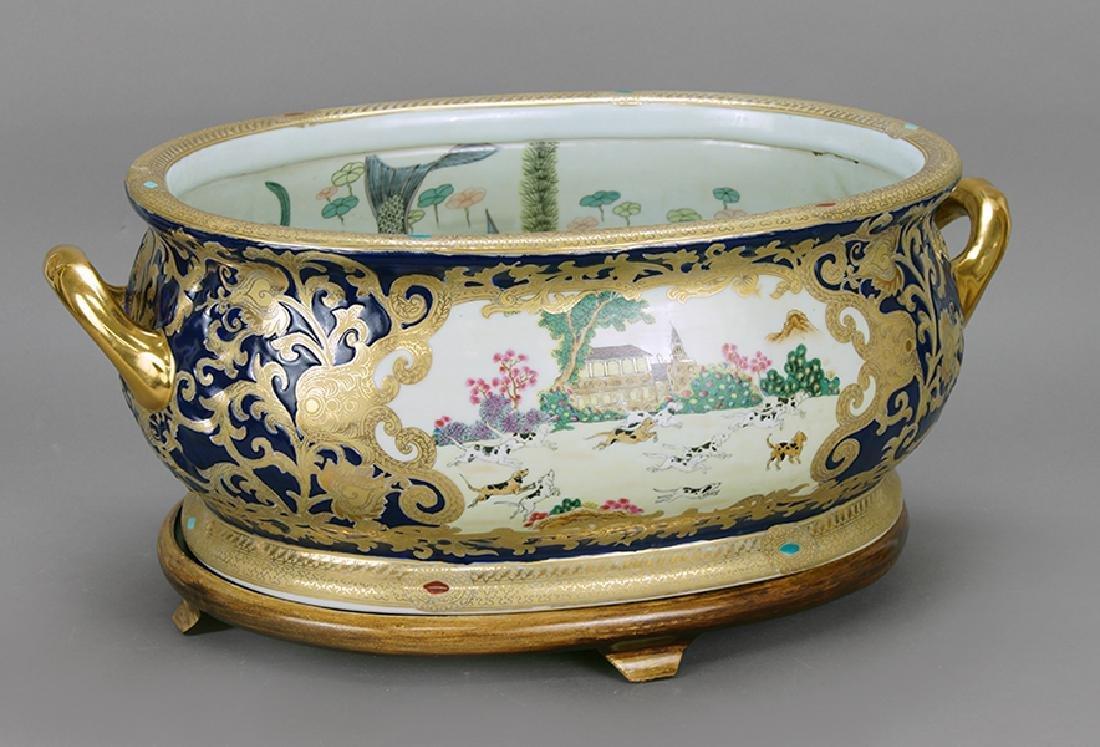 A Gilt Porcelain Footbath.