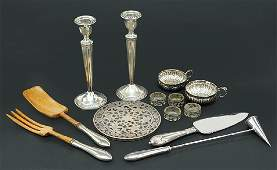 A Pair of Weighted Sterling Silver Candlesticks