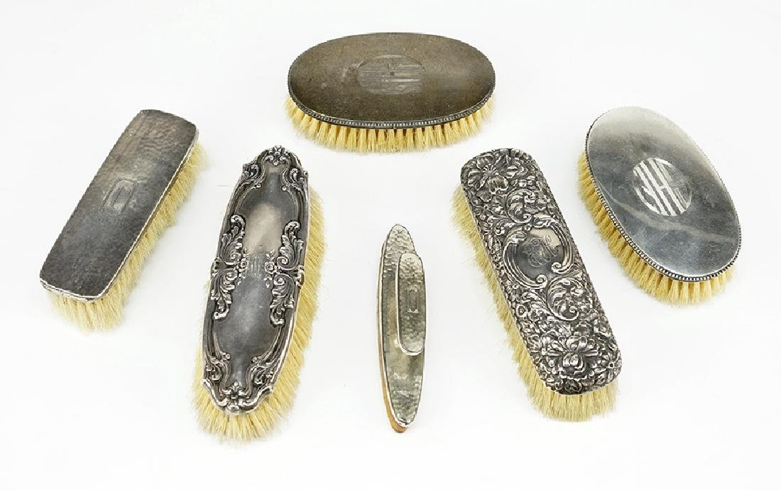 A Pair of French Silver Brushes.