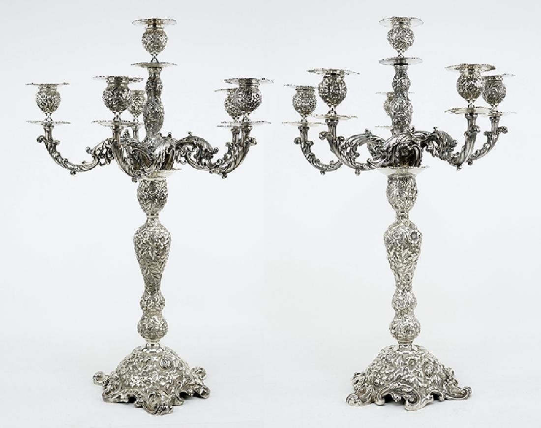 A Pair of Six-Light Sterling Silver Candelabra.