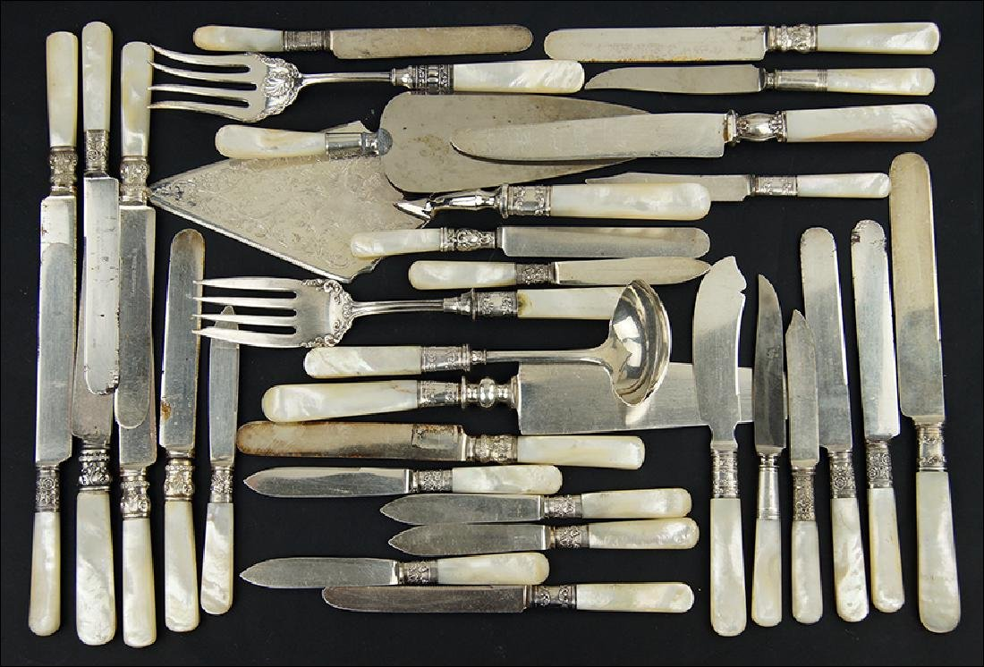 A Collection of Mother-Of-Pearl Handled Flatware.