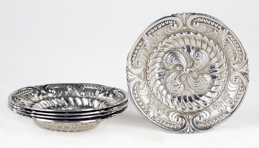 A Set of Five Spanish Silver Dishes.
