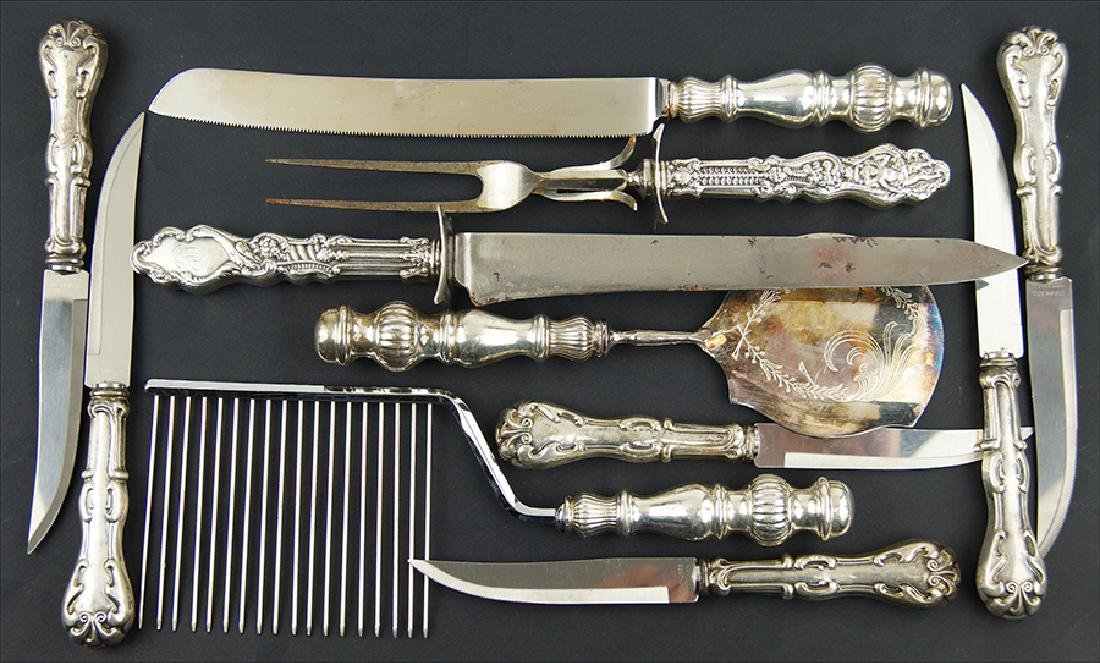 A Set of Six Sterling Silver Handled Steak Knives.