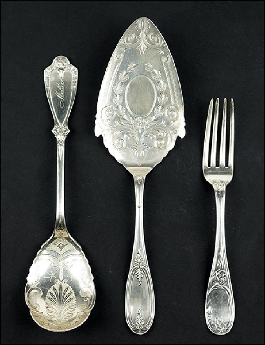 A Set of Twelve Coin Silver Luncheon Forks.