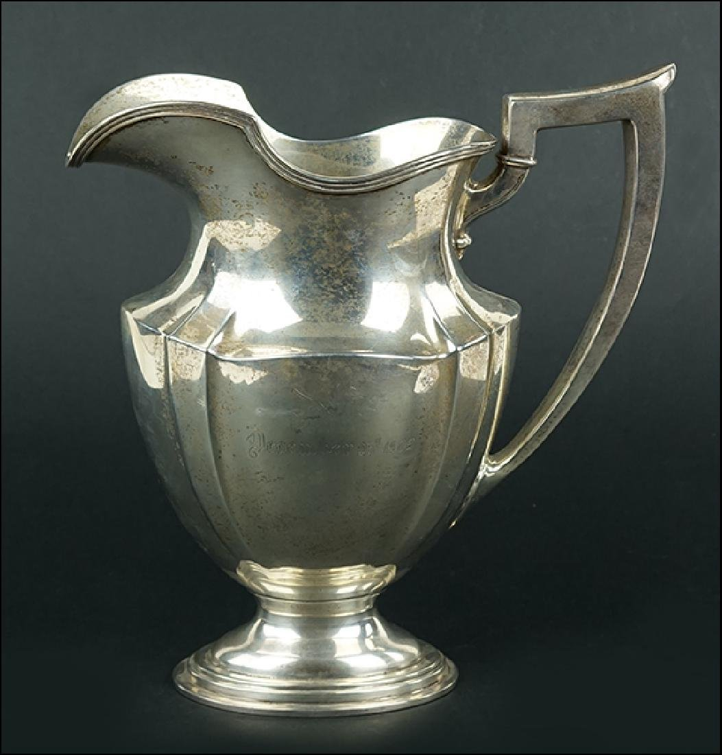 A Gorham Sterling Silver Water Pitcher.