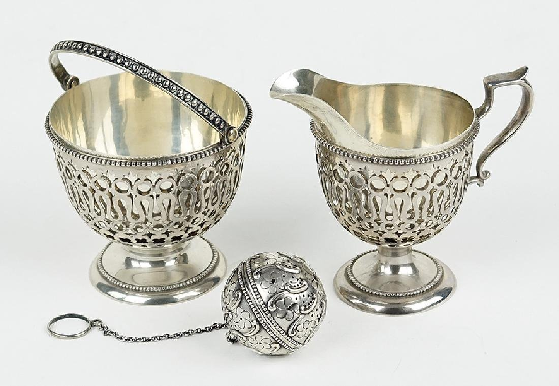 A Sterling Silver Creamer and Sugar Bowl.