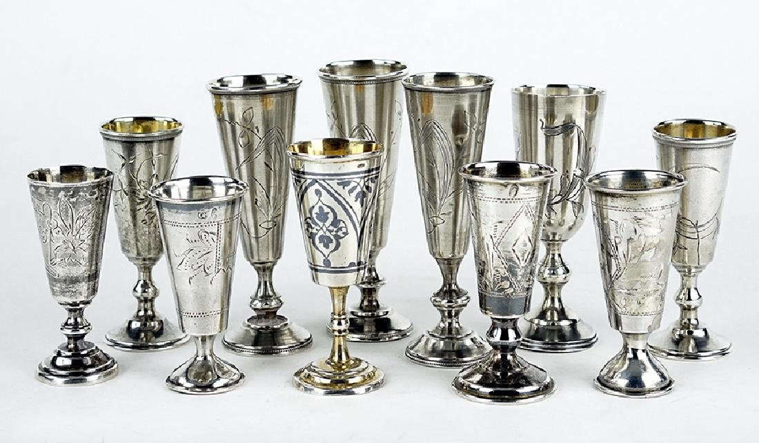 A Collection of Eleven .84 Silver Cups.