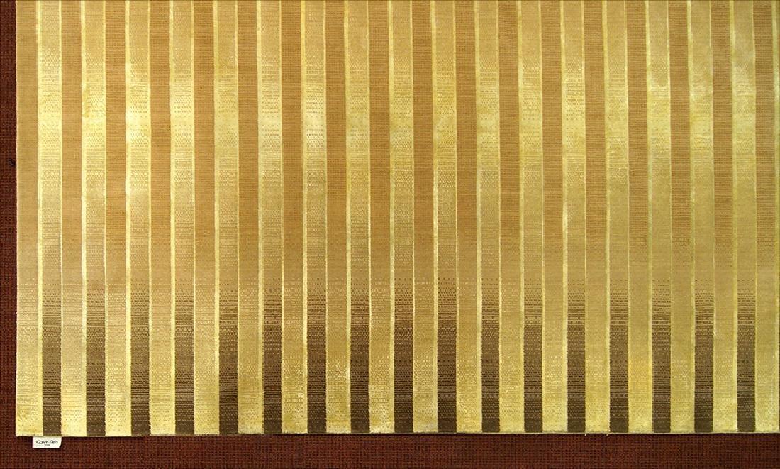 A Calvin Klein Wool Carpet.