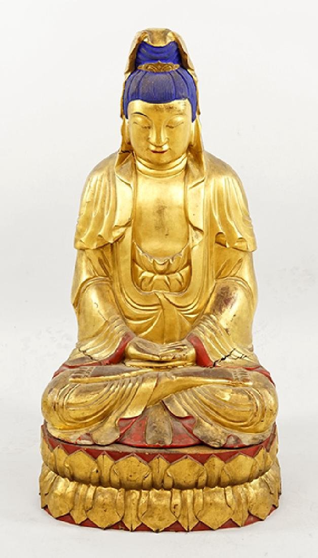 A Chinese Polychrome and Gilt Wood Buddha.