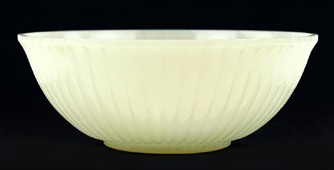 A Chinese Carved Celadon Jadeite Ribbed Bowl.