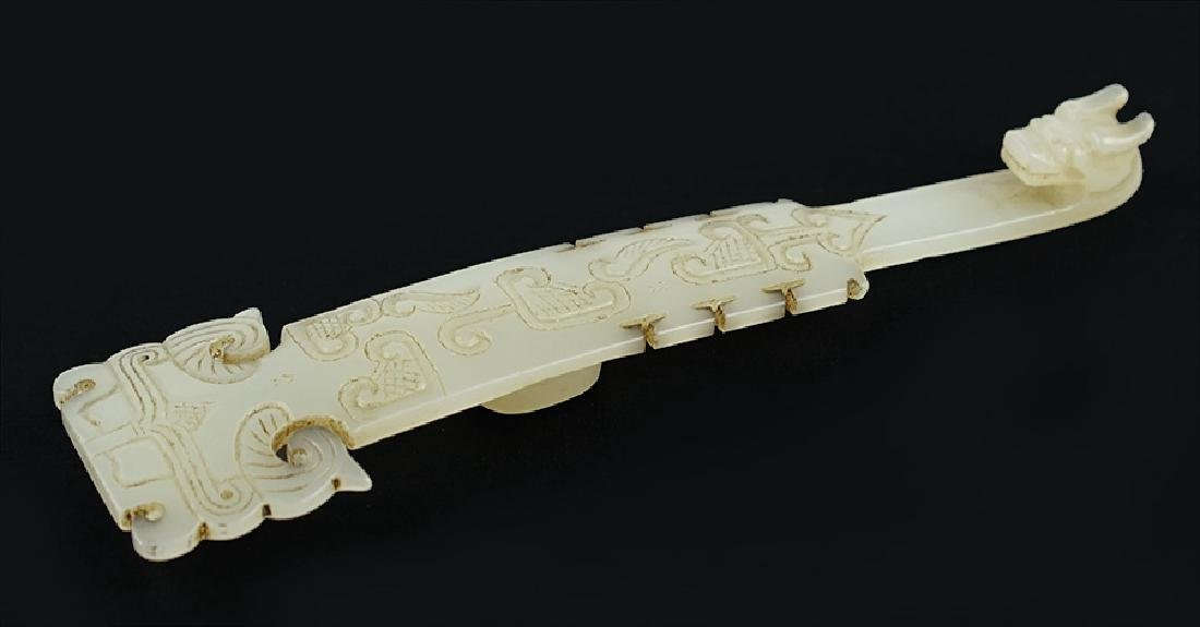 A Chinese Carved White Jade Belt Hook.