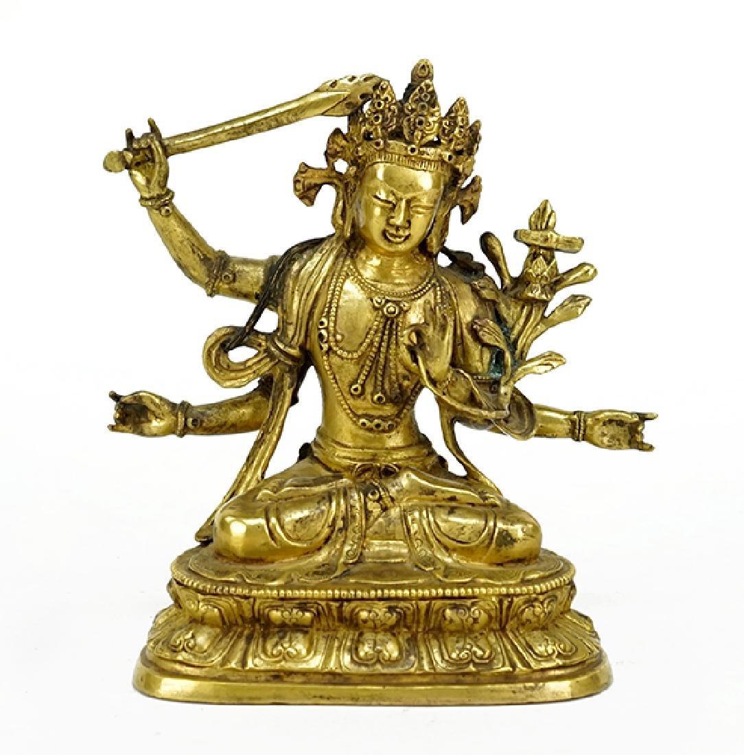 A Gilt Bronze Bodhisattva Manjusri Figure.