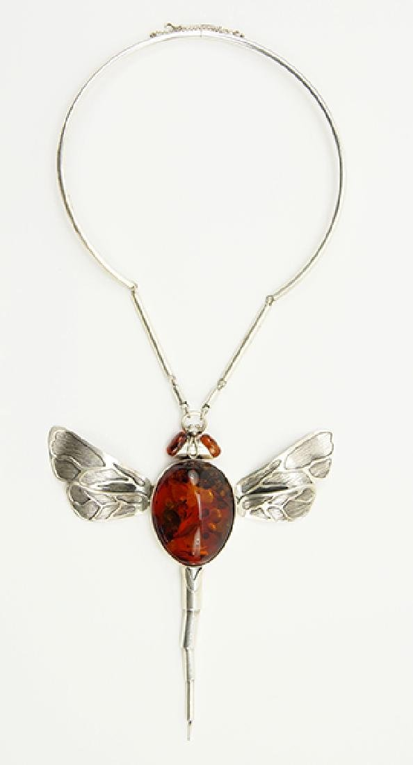 An Amber and Silver Necklace.