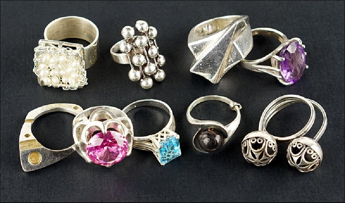 A Collection of Nine Sterling Silver Rings.