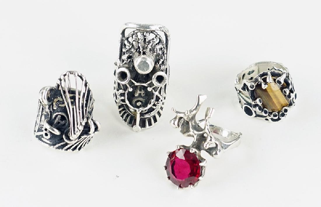 Four Lee Peck Sterling Silver Rings.