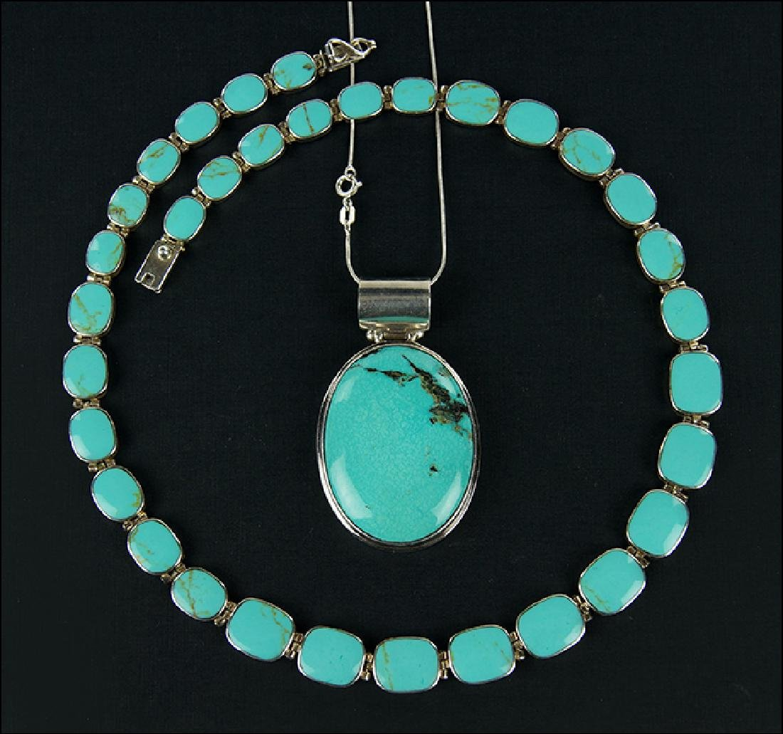 A Graduated Turquoise and Sterling Silver Necklace.