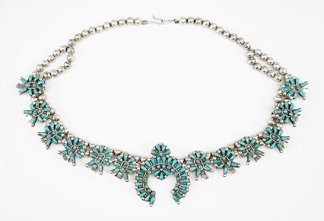 A Native American Squash Blossom Necklace.