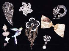 A Collection of Signed Brooches.