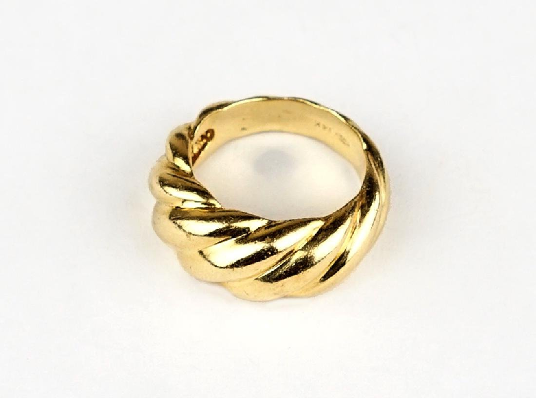 A 14 Karat Yellow Gold Ring.