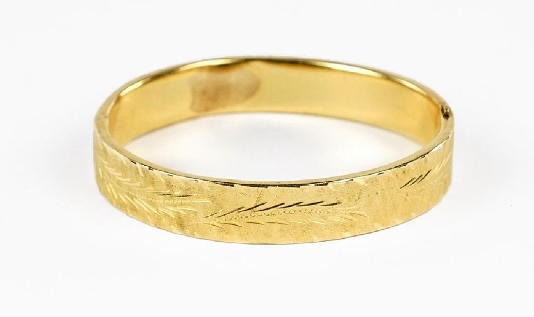 A 14 Karat Yellow Gold Bangle Bracelet.