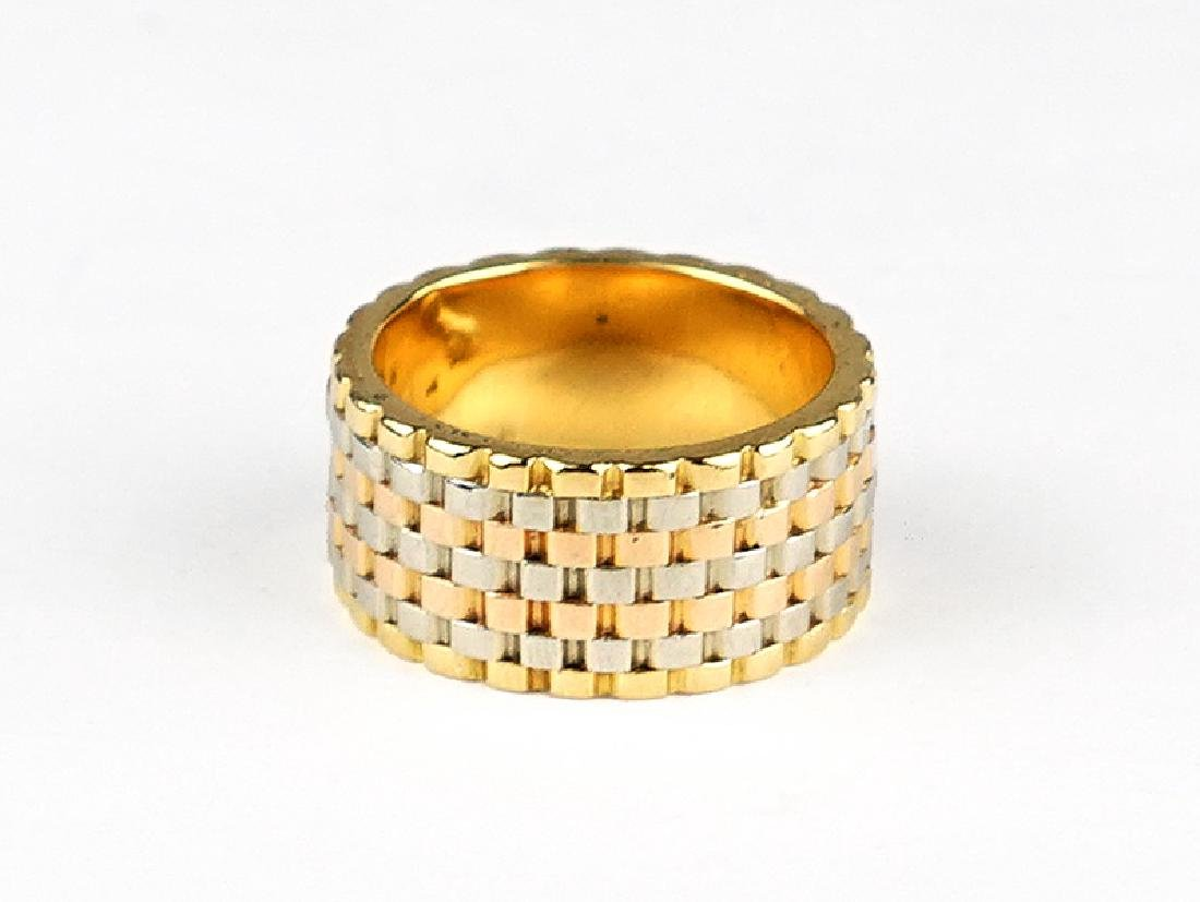 A Tri-Color 18 Karat Gold Ring.