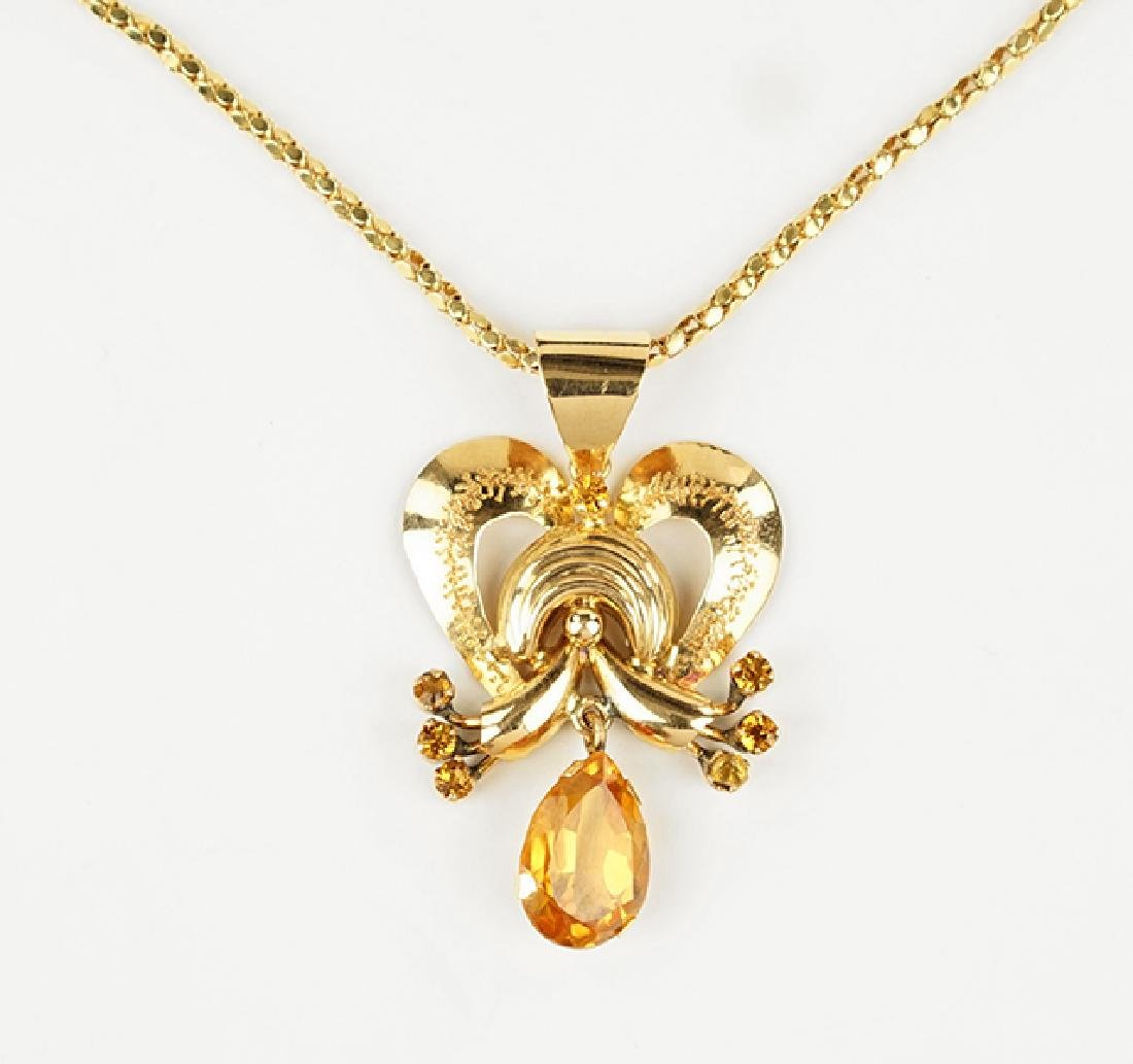 A Citrine and 18 Karat Rose Gold Pendant Necklace.
