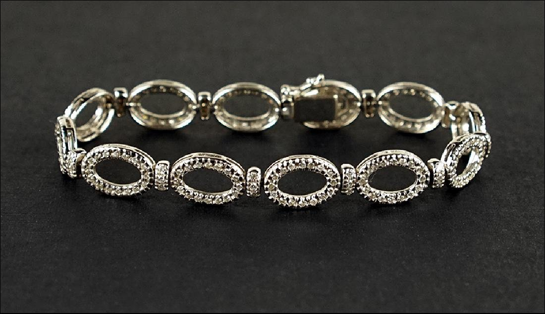 A Diamond and 18 Karat White Gold Bracelet.