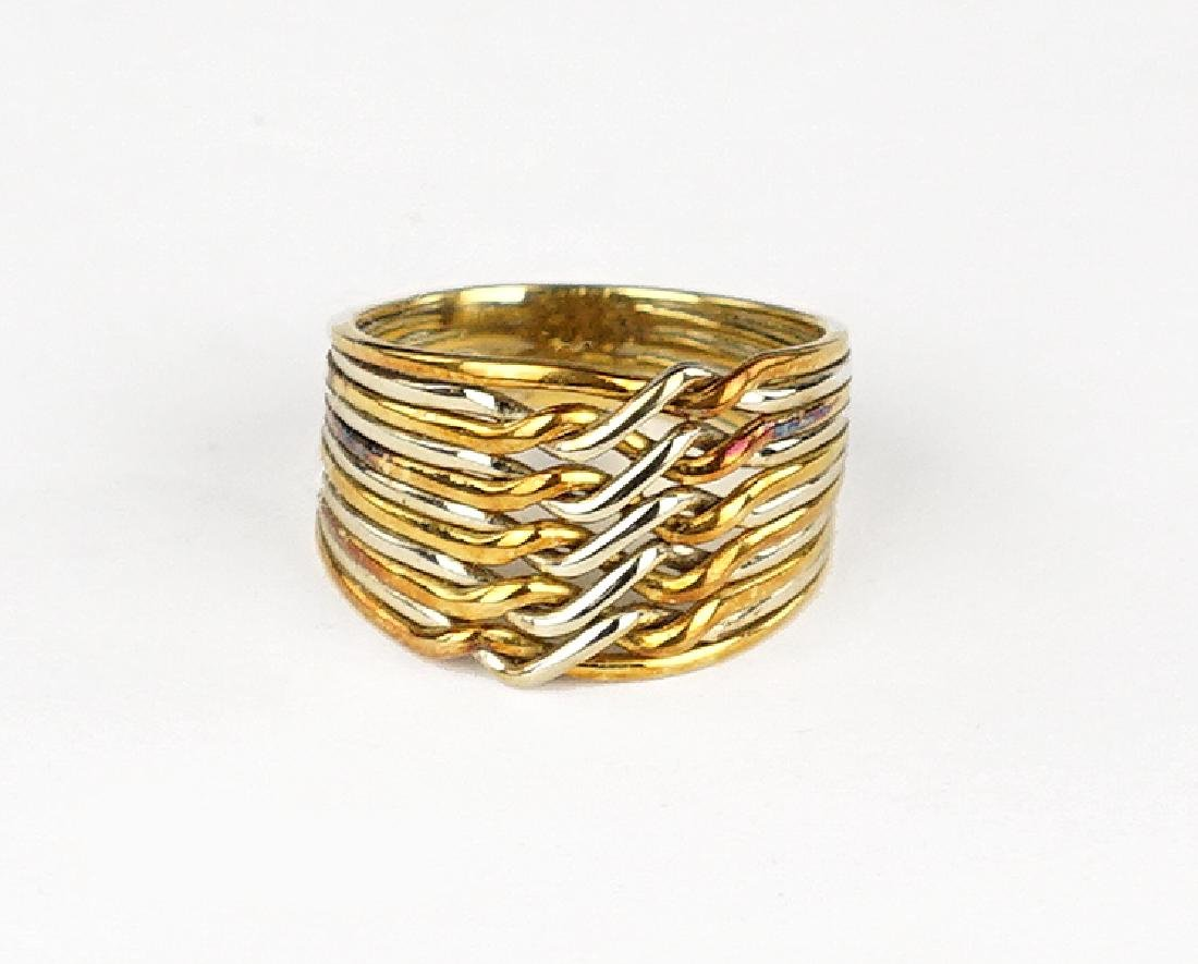 An 18 Karat Gold Ring.