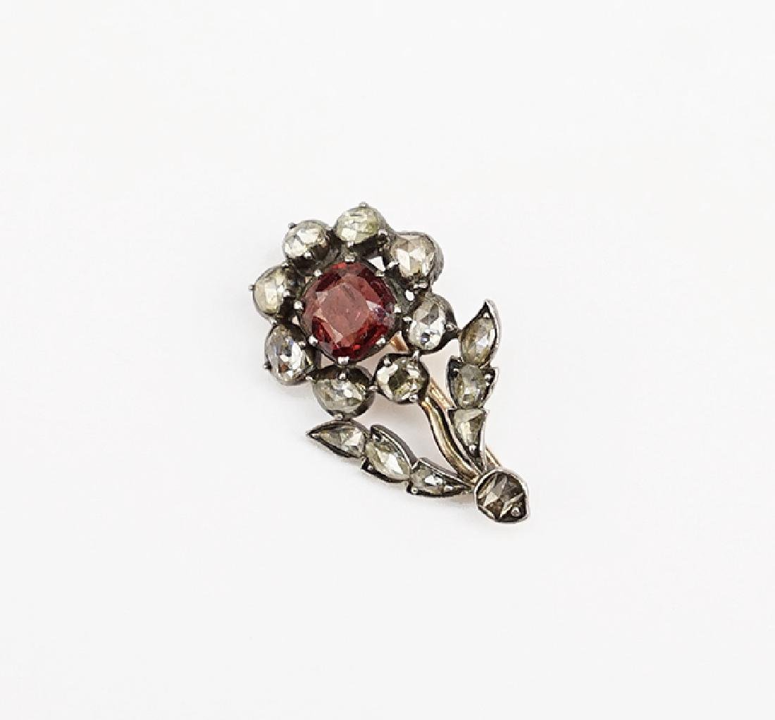 A Garnet and Diamond Brooch.