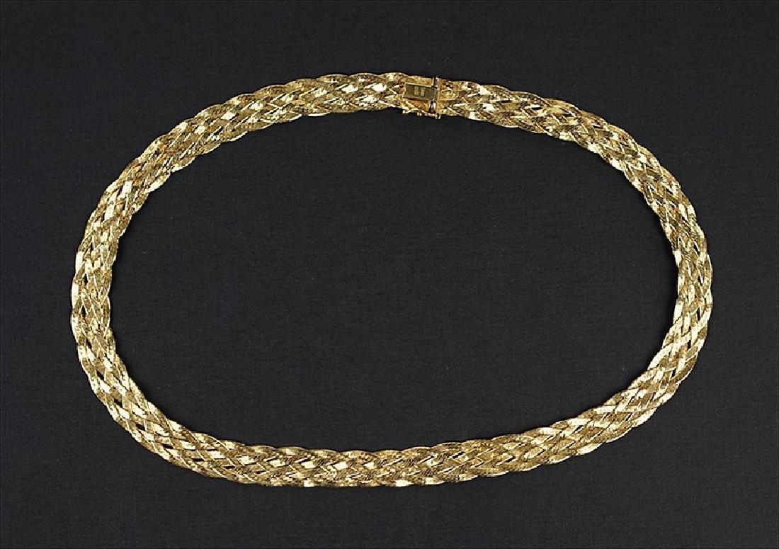 A Woven 14 Karat Yellow Gold Necklace.