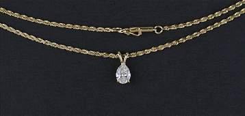 A Diamond and 14 Karat Yellow Gold Pendant Necklace