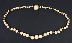 A Graduated Angel Skin Coral Bead Necklace