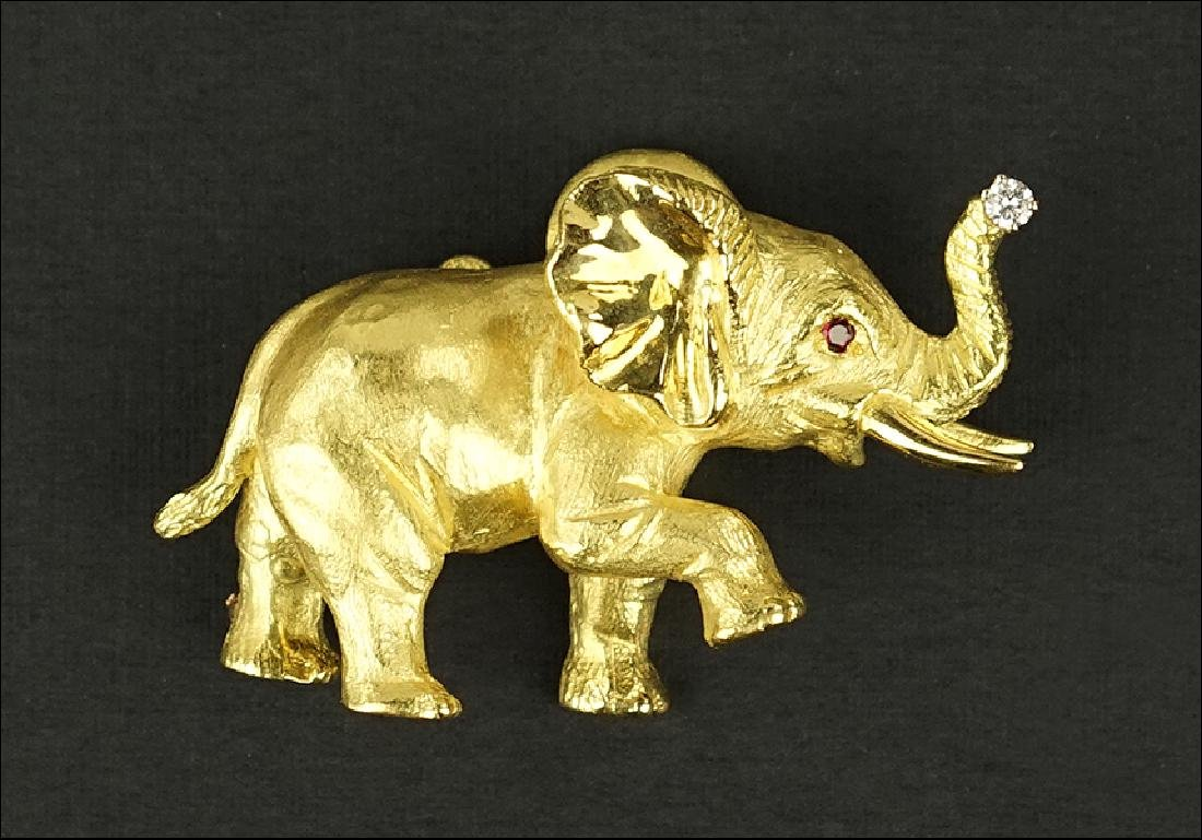 An 18 Karat Yellow Gold Elephant Brooch / Pendant.