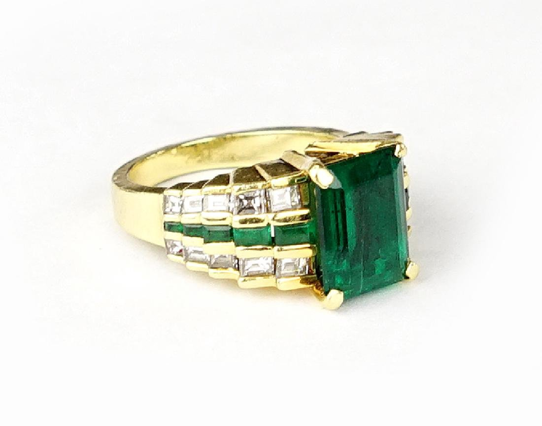 A Lester Lampert Emerald and Diamond Ring.