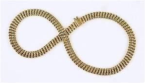 A Tiffany & Company 14 Karat Yellow Gold Necklace.