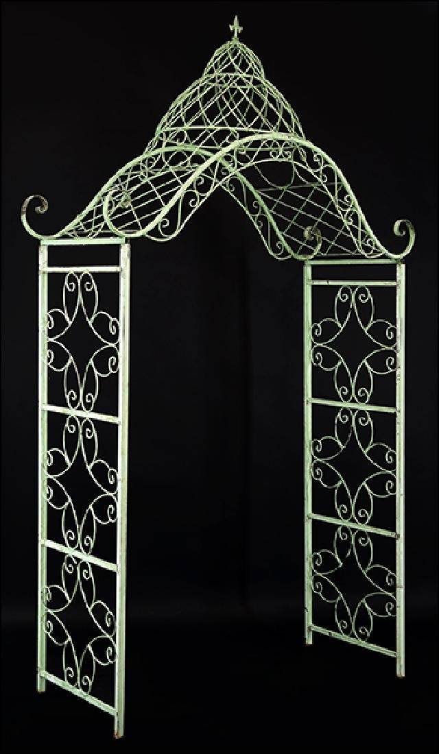 A Painted Scrolled Metal Arbor.