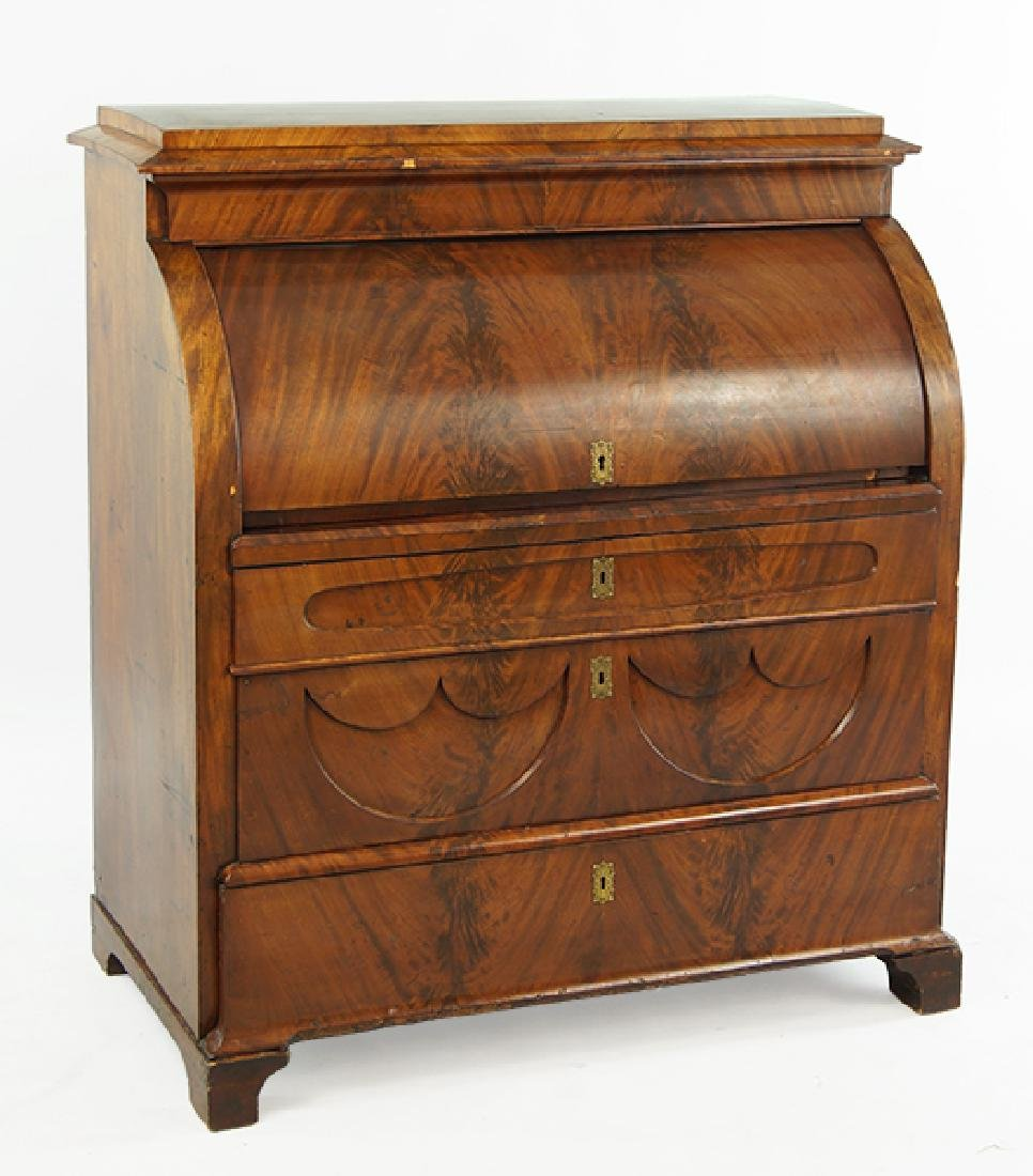 An Empire Mahogany Roll Top Secretary.