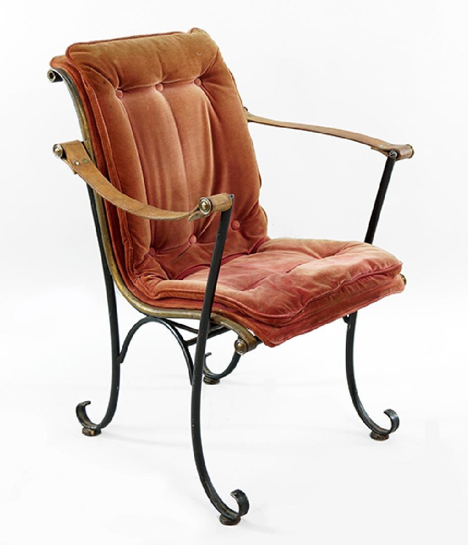 A Neoclassical Style Campaign Chair.