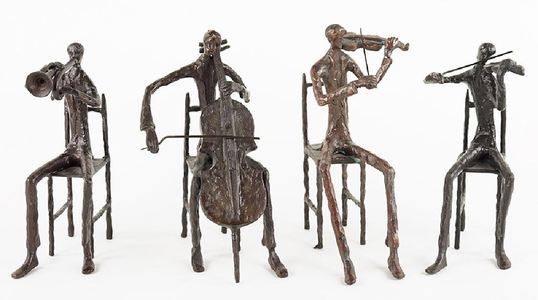 A Set of Four Patinated Metal Seatd Figures.