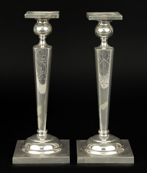 A Pair of Sterling Silver Candlesticks.