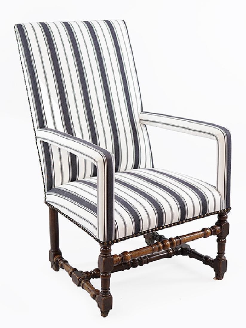 A 19th Century Highback Armchair.